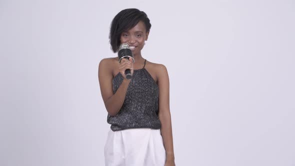 Thumbnail for Happy Young Beautiful African Woman Singing with Microphone