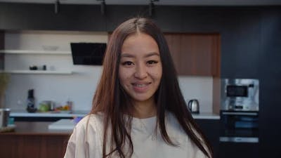 Portrait of Lovely Asian Woman with Braces Smiling