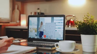 Online Video Conference on Laptop with Female Speaker in Home Office