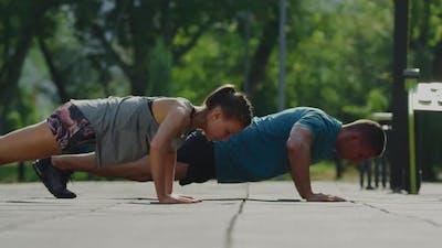 Couple doing push-ups