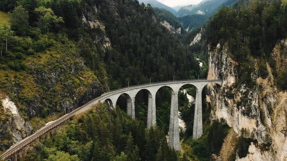 Thumbnail for Drone Flying Above Famous Landwasser Viaduct Bridge, World Heritage Destination in Summer Graubunden