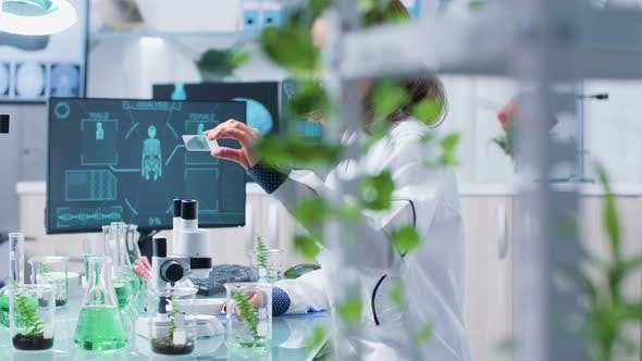 Thumbnail for Senior Biochemist Looking at Some Green Bio Samples