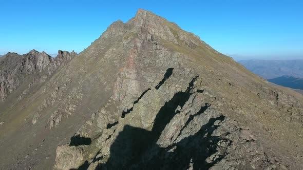 Thumbnail for Steep Cliff Cut on Mountain Ridge