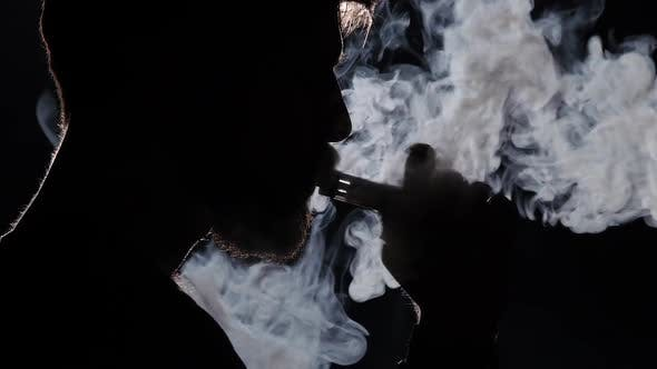 Thumbnail for Electronic Cigarette. Exquisitely Beautiful Smoke. Black. Silhouette. Close Up