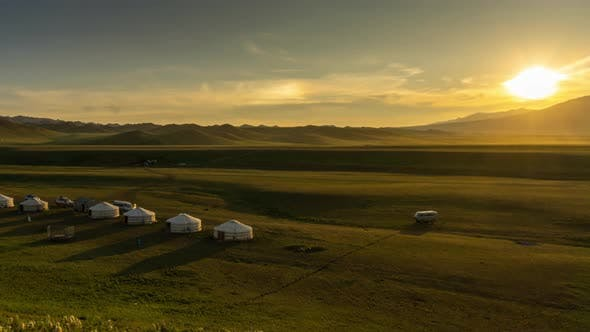 Traditional Yurts and Mountains at Sunset Mongolia