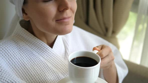 Thumbnail for Woman Smelling Coffee In Cup