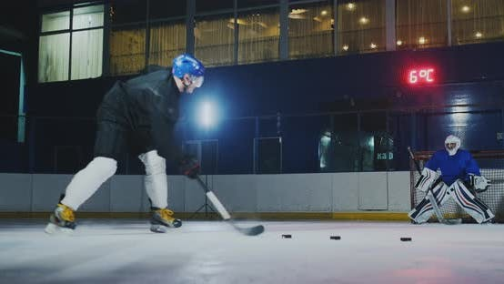 Thumbnail for Professional Hockey Player and Goalkeeper Train Punching Puck on Goal