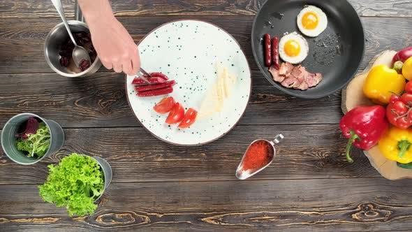 Hand Preparing English Breakfast