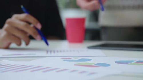 Hands of Startup Team Discussing Statistics