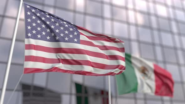 Flags of the USA and Mexico in Front of a Modern Skyscraper