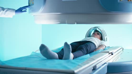 Boy During Brain MRI Scanning in Hospital