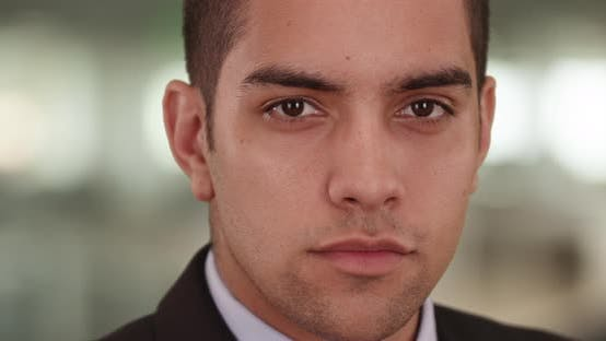Thumbnail for Close up portrait of Confident Latino businessman in office looking at camera