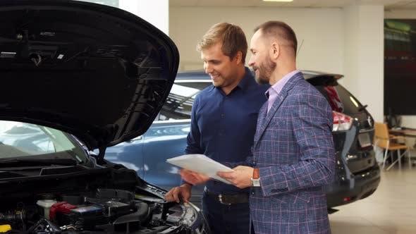 Thumbnail for A Representative Man Chooses New Car in the Car Salon