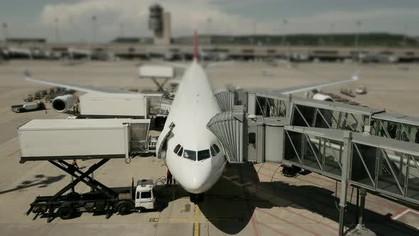 Thumbnail for Commercial Airplane Standing at Busy Airport Terminal