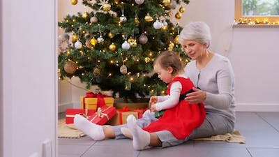 Grandmother and Baby Girl with Christmas Gifts