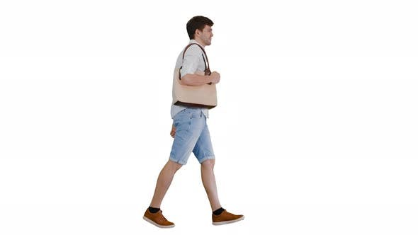 Thumbnail for Handsome Smiling Man in White Shirt Walking with a Bag on His Shoulder on White Background