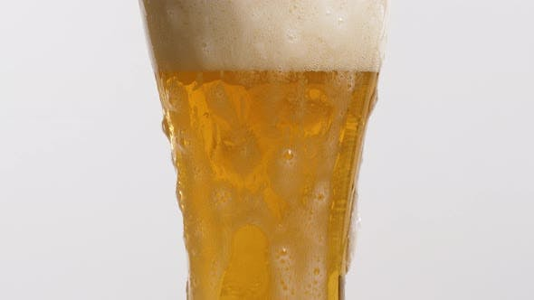 Thumbnail for A Glass of Beer With a Foam