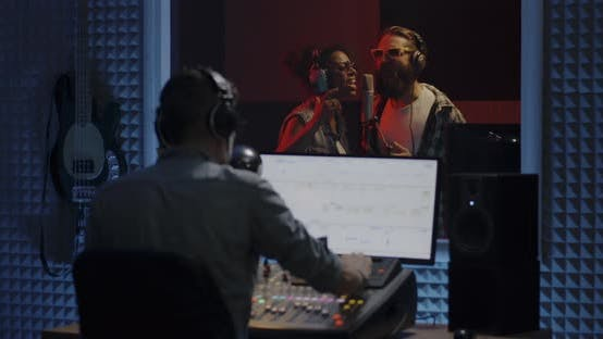 Thumbnail for Singers and Sound Engineer in Studio