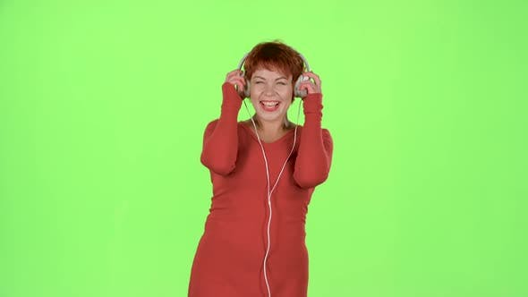 Thumbnail for Woman Listening To Music on Headphones. Green Screen