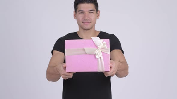 Thumbnail for Young Happy Multi-ethnic Man Giving Gift Box
