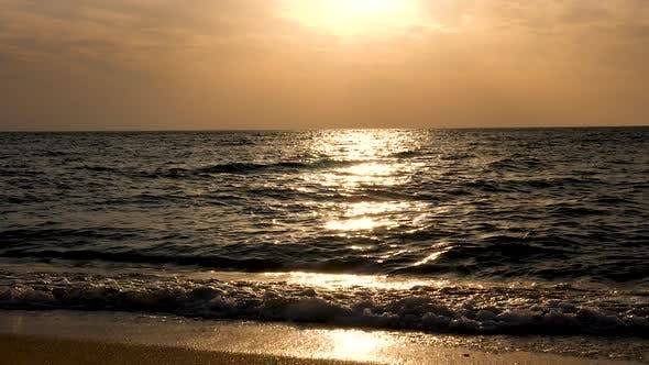 Cover Image for Sea at the Sunrise with Sun Rays Reflection on the Water
