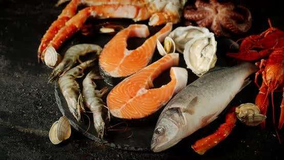 Thumbnail for Fish and Seafood Rotate on a Stone Board.
