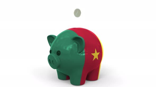 Thumbnail for Coins Fall Into Piggy Bank Painted with Flag of Cameroon