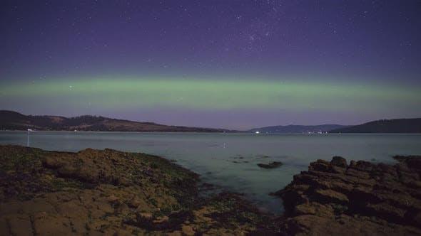 Thumbnail for 4K Timelapse of the Southern Lights (Aurora Australis) seen from Tinderbox, Tasmania, Australia