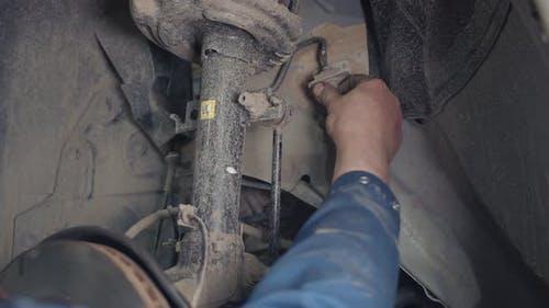 Car Brake Disc And Brake Pads Repair in the Car Repair Shop