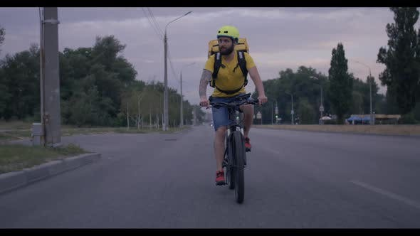 Thumbnail for Bicycle Messenger Cycling on a Road