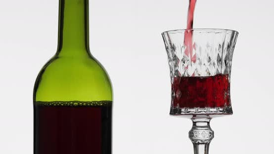 Rose Wine. Red Wine Pour in Wine Glass Over White Background