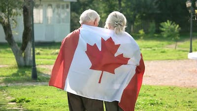 Old Couple Wrapped in Flag.