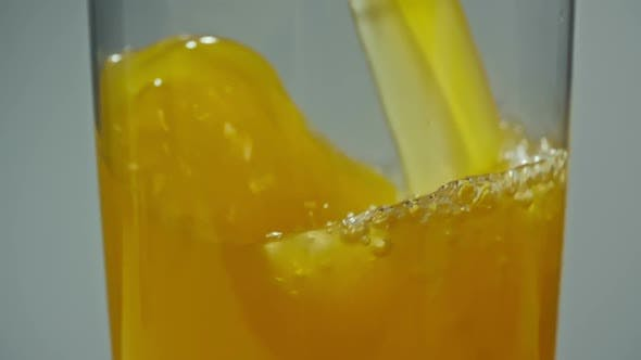 Thumbnail for Pouring Fresh Squeezed Orange Juice in Glass
