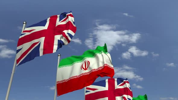 Waving Flags of Iran and the United Kingdom