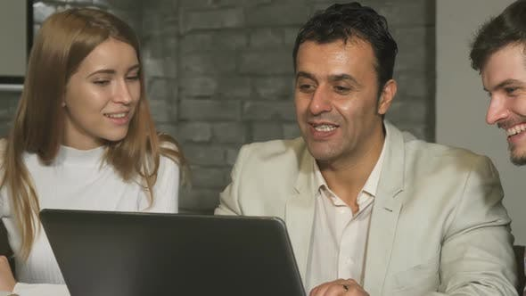 Cover Image for Group of Business People Laughing and Talking at the Office