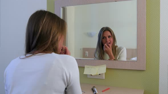 Morning Routine of Girl Applying Make-up Before Going To a Meeting