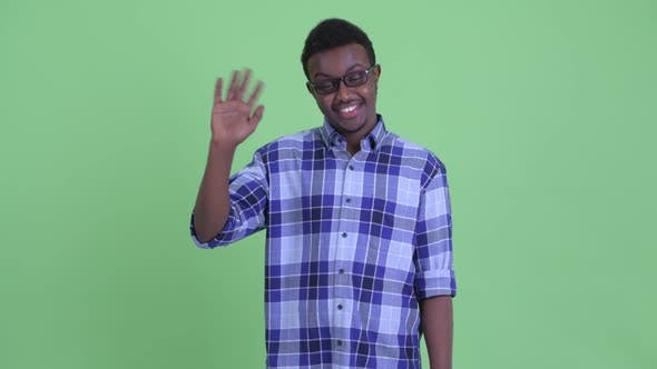 Cover Image for Happy Young African Hipster Man with Eyeglasses Waving Hand