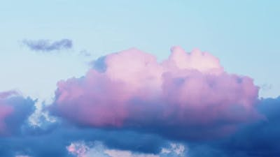 Fantastic Pink and Blue Fluffy Clouds Float Across Clear Sky