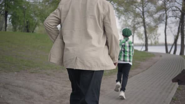 Thumbnail for Little Boy Running Away From His Grandfather in the Park