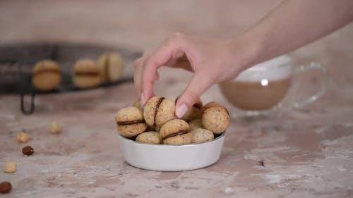 Baci Di Dama Homemade Italian Hazelnut Biscuits Cookies with Chocolate and Cup of Coffee