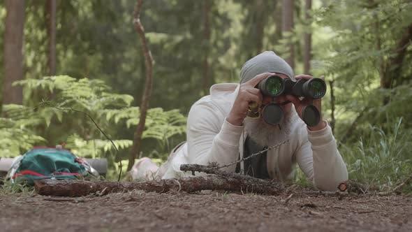 Thumbnail for Aged Hunter Using Binoculars