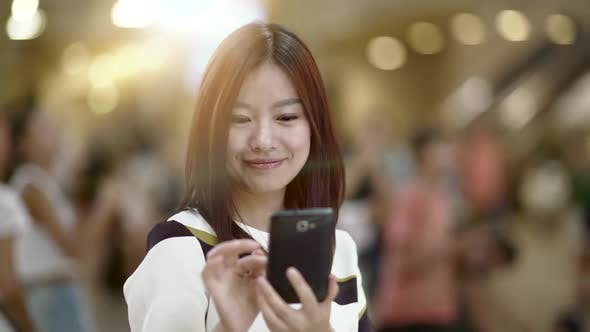 Thumbnail for Beautiful Asian Female Using Smart Phone Tablet