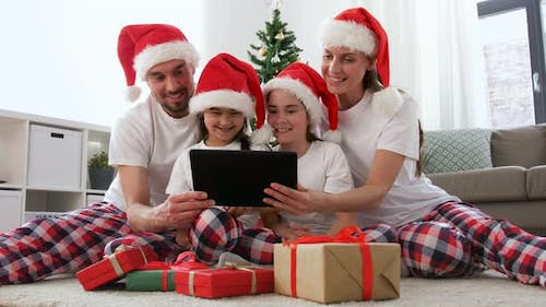 Family with Christmas Gifts Has Video Call at Home