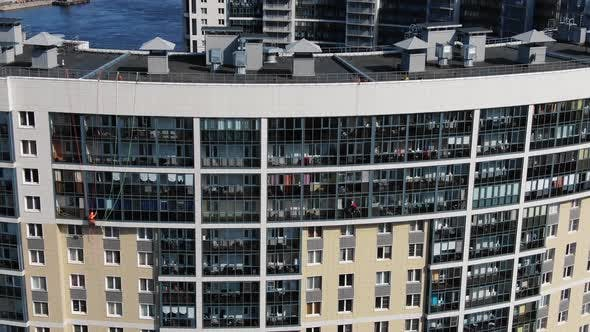 Skilled Industrial Climbers Wash Windows on Office Facade