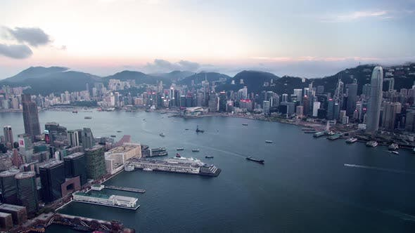 Cityscape Hong Kong with Illuminated Districts at Twilight