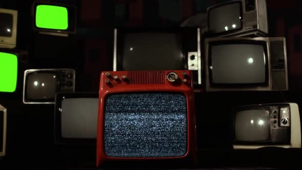 A Vintage TV Wall with Intermittent Green Screens switching Into an Old TV with Green Screen.