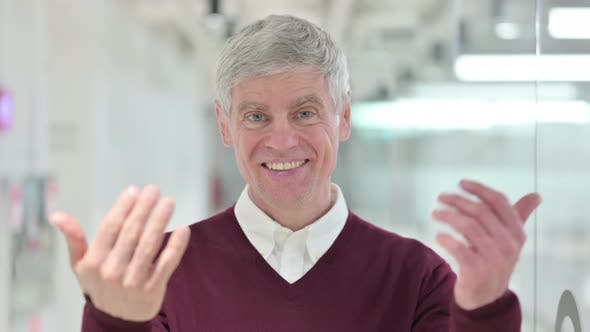 Thumbnail for Assertive Middle Aged Man Pointing and Inviting