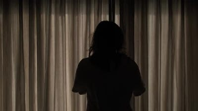 Young Woman Silhouette Opening Curtains at Morning