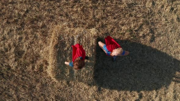 Top View of Dad with Son As Superheroes Outdoors
