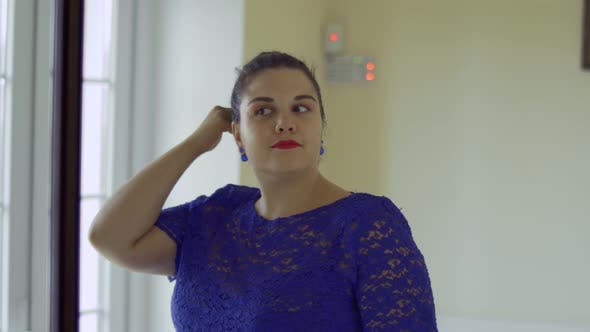 Thumbnail for Fat Girl in a Blue Dress in Front of a Mirror